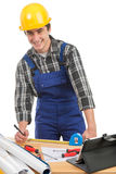 A worker measuring a board Royalty Free Stock Image