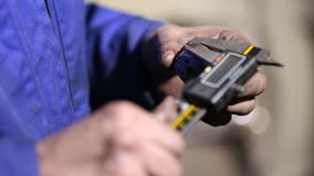 Worker measuring caliper. The item closeup stock footage