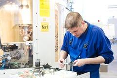 Worker measuring detail Royalty Free Stock Photo