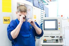Worker measuring detail Stock Photography