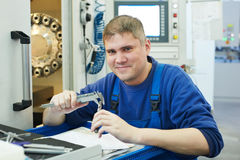 Worker measuring detail Stock Image