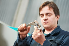 Worker measuring detail with caliper Royalty Free Stock Photography