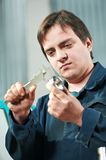 Worker measuring detail with caliper Stock Photography