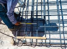 Worker measuring distance of the foundation rebar in reinforced concrete Royalty Free Stock Photos