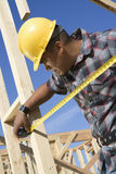 Worker Measuring Framework At Site Stock Photos