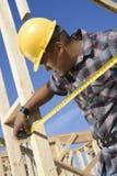 Worker Measuring Framework At Site Stock Photos