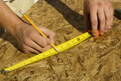 Worker Measuring Plywood Stock Photo