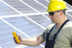 Worker is measuring solar insolation on the solar power plant Stock Image