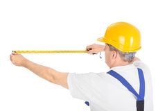 Worker with measuring tape Royalty Free Stock Photos