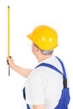 Worker with measuring tape, vertical Stock Images