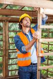 Worker Measuring Timber Frame Royalty Free Stock Images