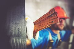 Worker with Measuring Tool Royalty Free Stock Photography