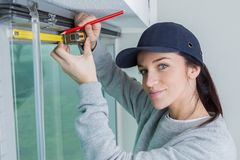 Worker measuring widow blinds royalty free stock photo