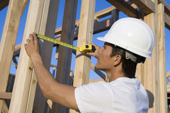 Worker Measuring Wooden Beams On Site Stock Photos