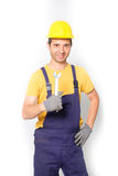 Worker mechanic holding a wrench isolated Royalty Free Stock Photos