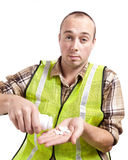Worker and Medication Royalty Free Stock Images