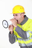 Worker with megaphone stock image
