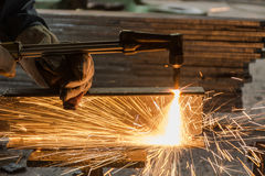 Worker metal Cutting With acetylene welding cutting torch.  Stock Photos