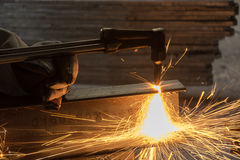 Worker metal Cutting With acetylene welding cutting torch Royalty Free Stock Photos