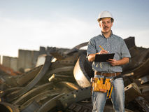 Worker in metal landfill Royalty Free Stock Photos