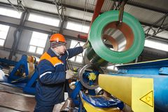 Worker at metal sheet profiling factory Royalty Free Stock Photos