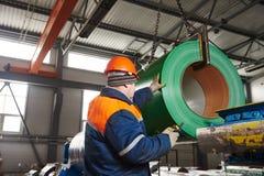 Worker at metal sheet profiling factory Royalty Free Stock Image