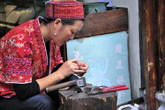 A worker of miao nationality jewelry Royalty Free Stock Images