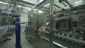 Worker On Milk Products Line At Dairy stock footage