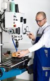 Worker at milling machine Royalty Free Stock Photography