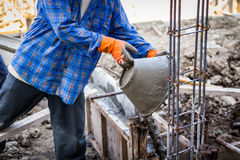 Worker mixing cement mortar plaster Royalty Free Stock Photo