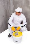 Worker mixing a plaster with a trowel Stock Photos