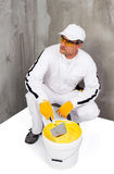 Worker mixing a plaster with a trowel Stock Image