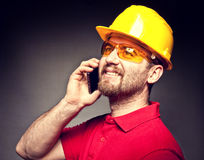 Worker with mobile Stock Photography