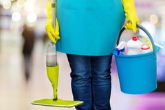 A worker with a MOP and bucket . A worker with a MOP and bucket on blurred background royalty free stock photos