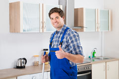 Worker Mopping Floor. Young Happy Worker In Overall Mopping Floor Stock Photo