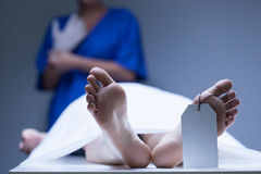Worker of morgue during job. View of worker of morgue during job Royalty Free Stock Photography