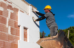 Free Worker Mounts Sheets Of Polystyrene Stock Photography - 78319832