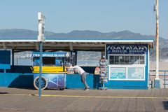 Getting Setup for the Workday. A worker moves his cart along the famous Santa Monica Pier in Los Angeles, California Stock Photography