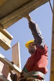 Worker Moving Boards - Vertical stock image