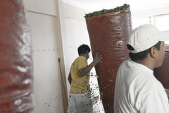 Worker moving large sack full of coca leaves at The Coca Leaves Depot in Chulumani stock image