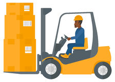 Worker moving load by forklift truck. Royalty Free Stock Photography