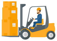 Worker moving load by forklift truck Royalty Free Stock Image