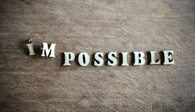 Worker moving on the word impossible to make possible Stock Photography