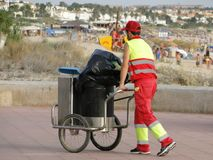 Public cleaning worker. Worker of the municipal cleaning services. Street cleaner with red work suit Royalty Free Stock Photos