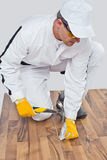 Worker nailed with a hammer wooden floor Royalty Free Stock Images