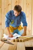 Worker near table Stock Photos