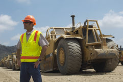 Worker Near Trucks At Landfill Site Royalty Free Stock Image