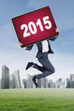 Worker with number 2015 on the board Stock Images