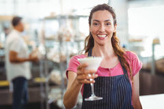 Worker offering a parfait Royalty Free Stock Photography