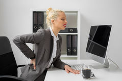 Worker at the office with terrible back pain Stock Images